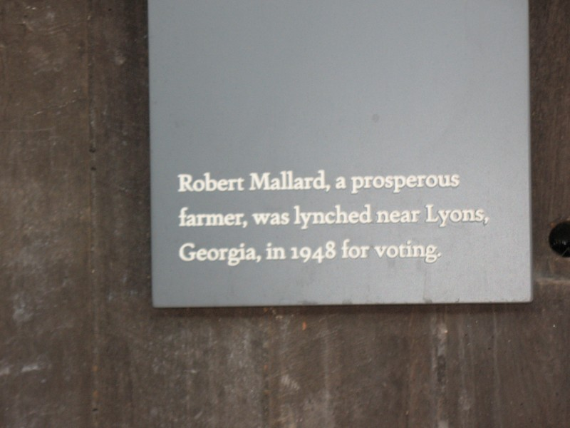 "Image of a placard that says, ""Robert Mallard, a prosperous farmer, was lynched near Lyons, Georgia in 1948 for voting."